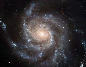 Scientists like Geoff Machin believe in phenomena like the Pinwheel Galaxy. Not so sure about God. Hubble Image, European Space Agency and NASA.