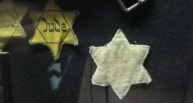 Auschwitz. Star of David patches were sewn on to the clothing of Jews during Nazi domination of Eastern Europe. On display at the Dohany Stree Synagogue, Budapest. Photo by Barbara Newhall
