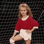 a 7-year-old girl who preferred soccer to her Bride Barbie doll. Photo by Barbara Newhall