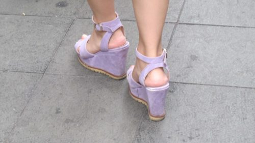 Super high -- feminine? -- wedge-heeled shoes worn by a woman in Shanghai. Photo by Barbara Newhall