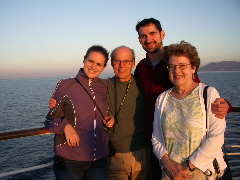 PHOTO TWO. The four of us a few minutes later in the glow of an Agean sunset.