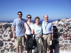 PHOTO FIVE. On the island of Santorini. The four of us and tons of tourists. And shops.