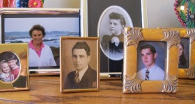 Family photos in frames on bedroom dresser. Photo by BF Newhall