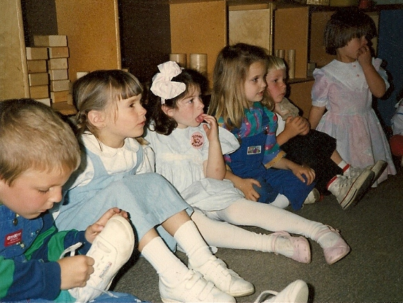 Preschool kids with hands on mouths & shoes. Photo by BF Newhall