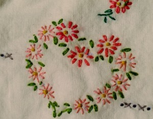 Mid 2oth century hand embroidered pillowcase with pink hearts. Photo by BF Newhall