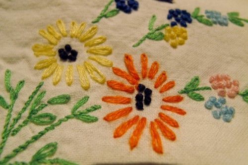 hand embroider pillowcase with french knots & daisies. Photo by BF Newhall.