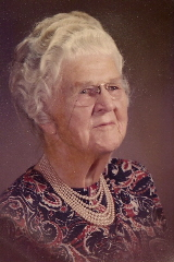 My Grandma Falconer at age 97 with pearls, up-do and 19th century-pince-nez.