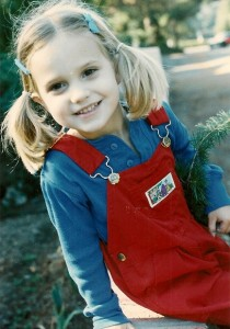 4-year-old girl in red overalls. photo by BF Newhall