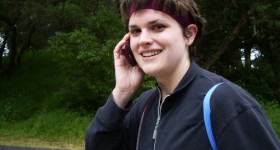 Christina Newhall with cell phone. Photo by BF Newhall