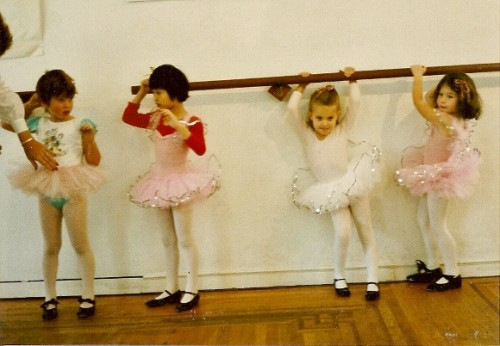 4 preschool ballerinas in tutus at barre. Photo by BF Newhall