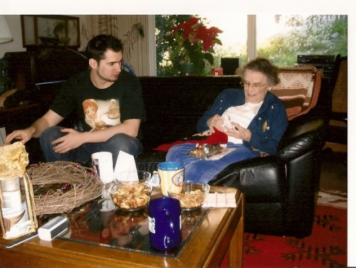 Young-man-&-his-grandmother-opening-Christmas-gifts. Photo by BF Newhall