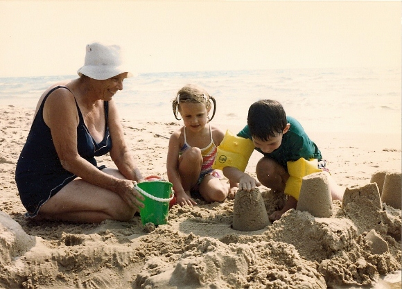 Small children with grandmother on Lake Michigan beach. Photo by BF Newhall.