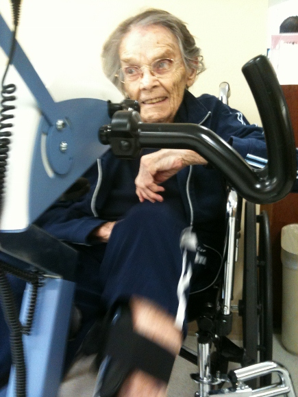 Tinka Falconer on the exercise bike after broken hip.