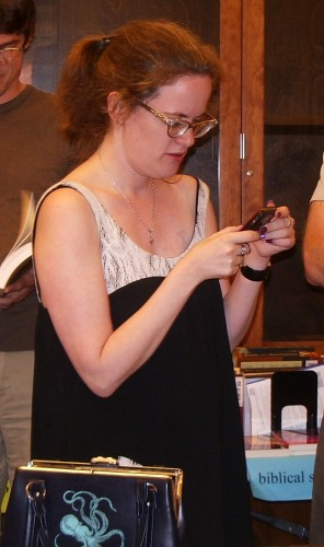 Memoirist Lauren Winner checking cell phone at The Glen, 2009. Photo by BF Newhall