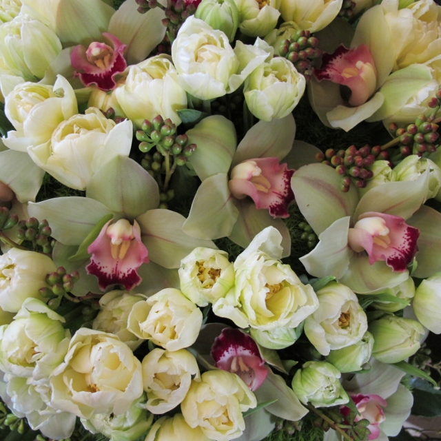 Floral arrangement with white tulips, pink and white orchids. Photo by Barbara Falconer Newhall.