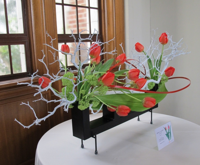 Floral arrangement with red tulips and grey branches. Photo by Barbara Falconer Newhall