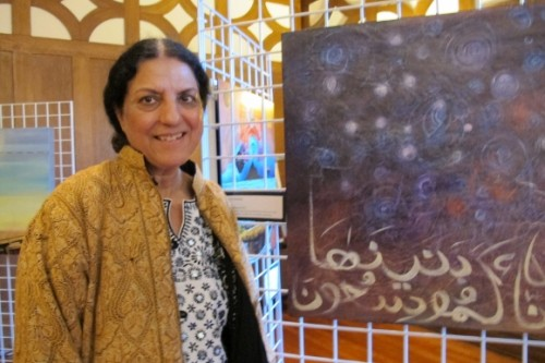 Berkeley CA  artist Salma-Arastu with her painting Expansion of the universe. Photo by BF Newhall