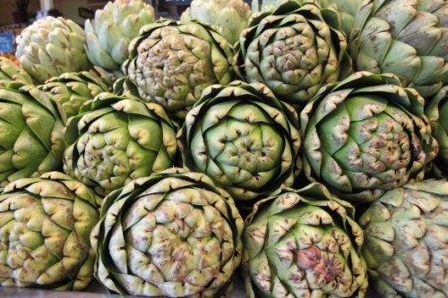 Artichokes stacked for sale at Whole Foods, Berkeley, CA. Photo by BF Newhall