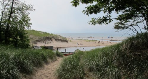 Sandy Lake Michigan beach with bathers. Photo by BF Newhall