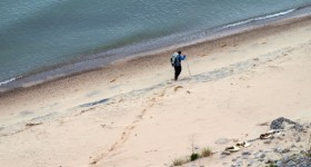Loreen Niewenhuis trekking across sand beach. Niewenhuis photo.