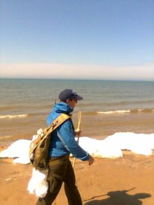 Loreen hikes alongside Lake Michigan snow drifts. Niewenhuis photo