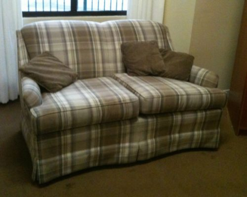 Love seat with plaid upholstery fabric. Photo by BF Newhall.