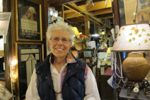 Sue Johnson in her custom lamp store, berkeley, ca. Photo by BF Newhall