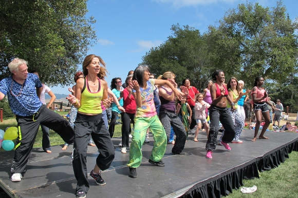 Zumba teachers lead a dance on stage at The Hills. Photo by Jon Newhall