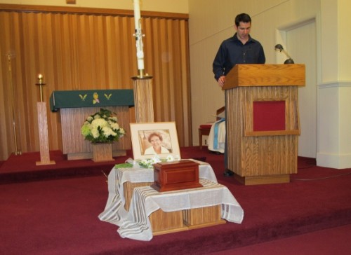 Peter Newhall reads Isaiah at his grandmothers memorial service, st. vincent church, pentwater, MI. Photo by BF Newhall