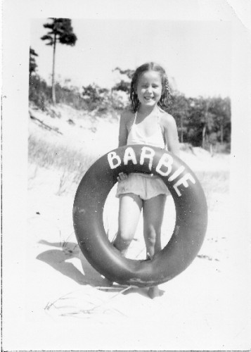 Barbara Falconer with inner tube on beach, MI. Photo by Tinka/DB Falconer