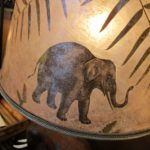 Mica shade with an elephant and other African animals by Lynn Duncan. Photo by BF Newhall.