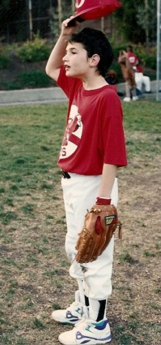 Peter Newhall lifts his baseball cap during practice. Photo 1991 by BF Newhall