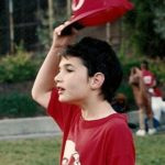 Peter Newhall lifts his Reds baseball cap during Piedmont CA rec department game. Photo 1991 by BF Newhall