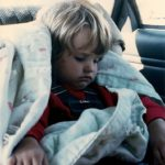 Three-year-old girl asleep with her blankie in her car seat. Photo by BF Newhall