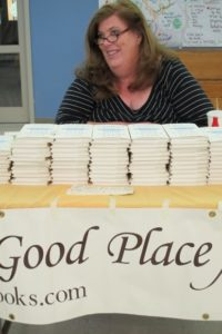 "Kathleen Caldwell, proprietor of A Great Good Place for Books, selling Anne Lamott's book, ""Help, Thanks, Wow."" Photo by BF Newhall"