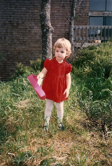 Three-year-old girl in a red dress looking forlorn. Photo by BF Newhall