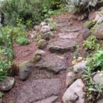 A lava rock steppingstone garden path. Photo by BF Newhall