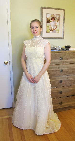 Bride posing in her future mother-in-law's wedding dress. Photo by BF Newhall