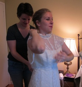 Bride-to-be tries on her future mother-in-law's wedding gown. Photo by BF Newhall