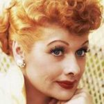Lucille Ball with red lipstick and hair