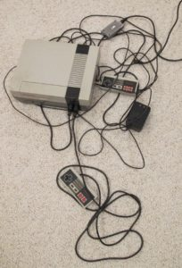 The original 1985 Nintendo Entertainment System console with controllers and wires. Photo by BF Newhall