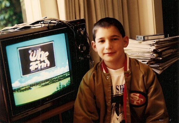 Ten-year-old Peter Newhall with monitor showing Final Fantasy game he has just won. Photo by BF Newhall