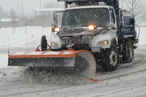 Snowplow clearing snow in a snowstorm in Eden Prairie, MN. Photo 2013 by BF Newhall