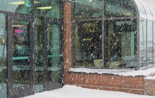 Fat snowflakes falling at the entrance to the Eden Prairie, MN, Community Center. Photo by BF Newhall.
