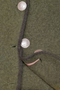 Loden green Walkjanker with dual button holes and Rudbertus coin buttons held with a ribbon. Photo by BF Newhall.