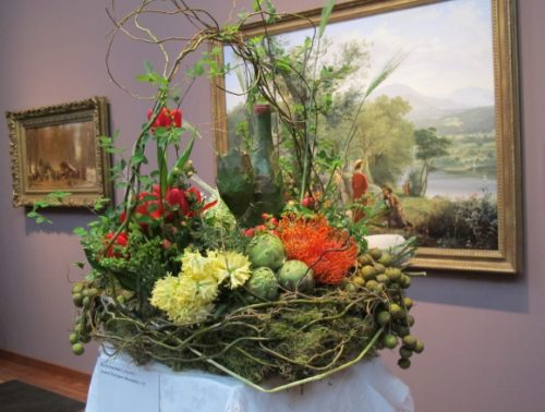 "Floral designer Dariel Alexander of Lafayette, CA, created a bucolic flower arrangement inspired by Jerome Thompson's 1857 painting of a picnic ""Recreation"""