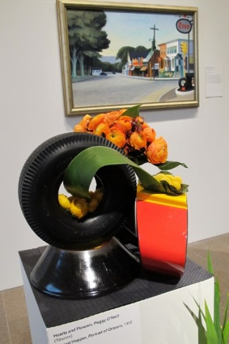 "Peggy O'Neill used a tire and orange flowers to reflect Edward Hopper's painting ""Portrait of Orleans"""