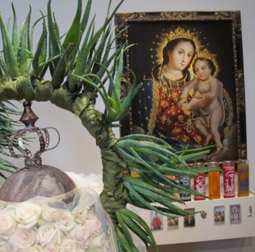 Nicole vidalakis of the san francisco garden club used spray roses and intertwined leaves in her floral arrangement complementing an image of Virgin and Child. Photo by BF Newhall