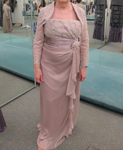 Barbara Falconer Newhall trying on a frumpy mother of the groom gown at David's Bridal Salon, Pinole, CA. Photo by BF Newhall