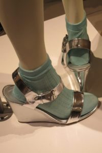 Chrome colored wedge shoes with buckle over green socks on a mannequin at the entrance to Nordstrom SF. Photo by BF Newhall